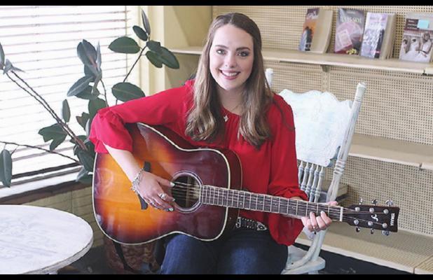 Rockdale High grad writes, sings way to win