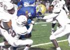 Yoemen defense keeps Bell in Cameron, 31-3